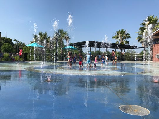 Toddlers play Monday morning in the Imagination Fountain at Cascades Park.