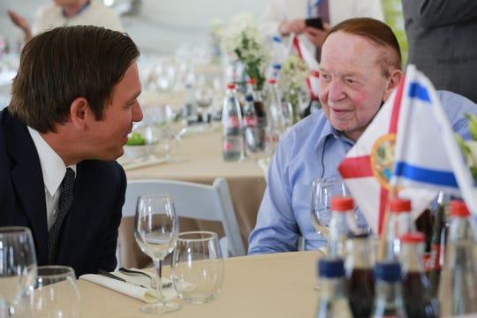 "Along with signing a memorandum of understanding with Ariel University, Ron DeSantis was presented with the Honorary Fellowship Award ""for his dedication, leadership and commitment to the State of Israel."" Present at the ceremony was philanthropist, mega Republican donor and casino magnate Sheldon Adelson (seen here with DeSantis)."