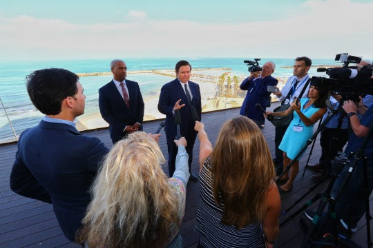 With the Mediterranean Sea as a backdrop, Gov. Ron DeSantis speaks to reporters ahead of the first-full day of a Florida trade delegation trip to Israel.