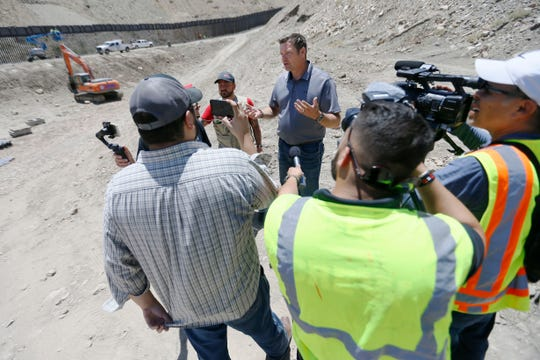 "Kris Kobach, general council to We Build the Wall, explains the materials the wall is made out of Monday, May 27. A wall is being built by Monument One, an official marker at the spot where New Mexico, Texas and the Mexican state of Chihuahua converge, by Border Highway West, near Executive Center Boulevard by the organization ""We Build the Wall"" organization on land owned by American Eagle Brick Company."