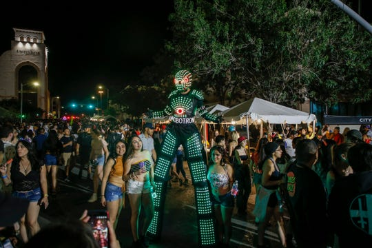 A tall robotron cosplayers posed for pictures with Neon Desert festivalgoers.