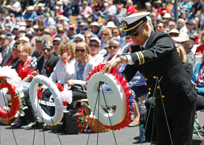A retired U.S. Navy veteran presents a wreath during the Memorial Day service at the Conejo Mountain Funeral Home, Memorial Park & Crematory in Camarillo in 2019.