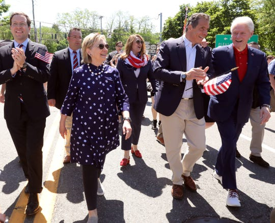 Former Secretary of State Hillary Clinton, Gov. Andrew Cuomo and former President Bill Clinton march in the annual Town of New Castle Memorial Day Parade in Chappaqua, N.Y. May 27, 2019.