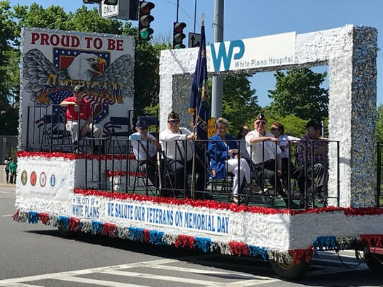 Veterans ride on a float in the White Plains Memorial Day parade, May 27, 2019.