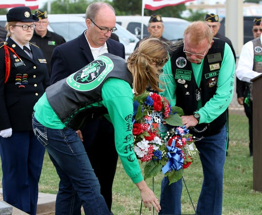 Jeff Milligan and the Green Knights place a wreath at the Wichita County Cemetery in remembance of fallen veterans Monday, May 27, 2019, for Memorial Day.