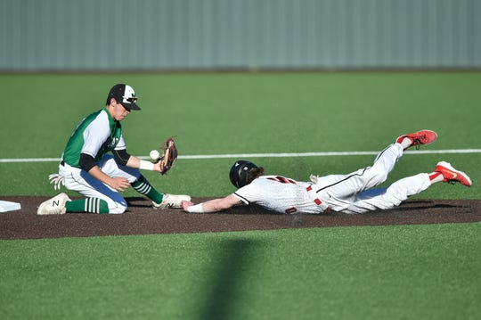 Argyle right fielder Hayden Clearman (10) steals second base, while Iowa Park second baseman Braxton Briones (10) attempts to tag him out  in a March game.
