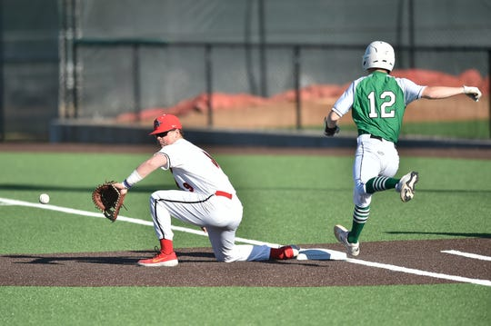 Argyle first baseman Chad Ricker (9) gets Iowa Park's Kaleb Gafford (12) out at first base in their March non-district meeting.