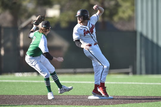 Argyle center fielder Dillon Carter (1) steals second base, while Iowa Park shortstop Kase Johnson (8) attempts to tag him in a March 14 meeting.