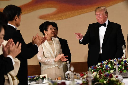 President Donald Trump attends a state banquet with Japanese Empress Masako at the Imperial Palace in Tokyo on May 27.