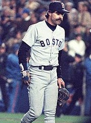 Bill Buckner walks off the field after the Red Sox lost Game 6 of the World Series.
