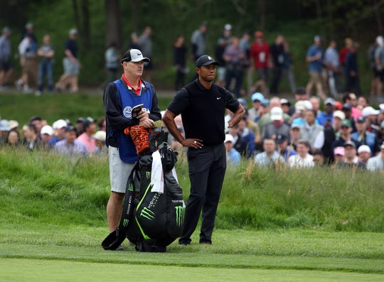 Regular caddie Joe LaCava, left, will take the Hero World Challenge off and hand Tiger Wood's bags over to a guest caddie.