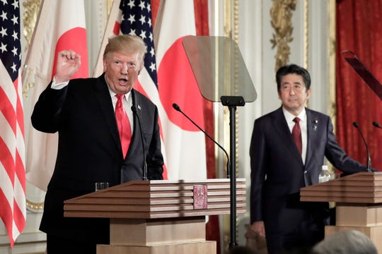 President Donald Trump holds a news conference with Shinzo Abe, Japan's prime minister,  at Akasaka Palace on May 27 in Tokyo.