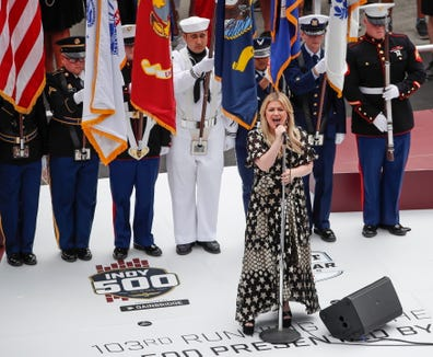 Kelly Clarkson sings the national anthem before the Indy 500 on Sunday.