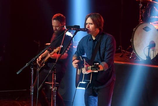 Nick Harmer, left, and Ben Gibbard of Death Cab for Cutie perform onstage during Death Cab For Cutie for iHeartRadio Live at the iHeartRadio Theater in 2015 in Burbank, California.
