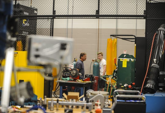 Ocean County Vocational Technical Schools held an open house to begin field trips to manufacturing companies under a new agreement with the New Jersey Economic Development Authority in Jackson on May 23, 2019. Jim Shockley Sr. and Jim Shockley Jr. of West Creek, tour the machinery room.