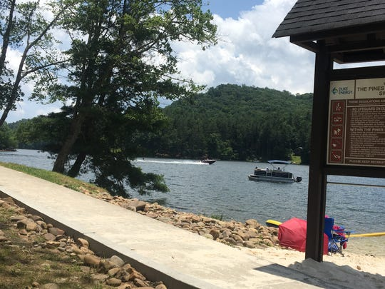 Signs at the Pines Recreation Area at Lake Glenville in Jackson County warn against swimming outside of the designated swim area or jumping from the fishing pier.