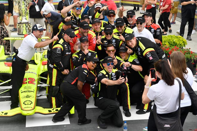 Crew chief Ben Bretzman, a Satellite High and UCF graduate, takes a selfie with Indy 500 winner Simon Pagenaud and the the Team Penske crew after Monday's victory at The Brickyard.