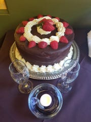 Stephanie Petrone Snavely's said wedding dinner at Cafe Margaux in Cocoa was perfect, especially the wedding cake.