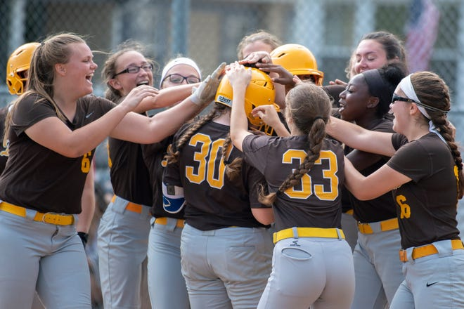 Delran's Brooke Acker (30) is embraced by teammates after hitting a home run against Audubon Tuesday, May 28, 2019 in Audubon, N.J. Delran won 4-1.