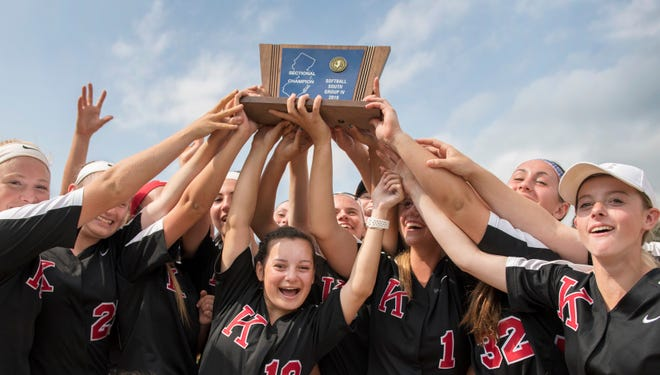 Members of the Kingsway High School softball team hoist their trophy after Kingsway defeated Shawnee, 13-3, in the South Jersey Group 4 softball championship game played at Shawnee High School in Medford on Tuesday, May 28, 2019.