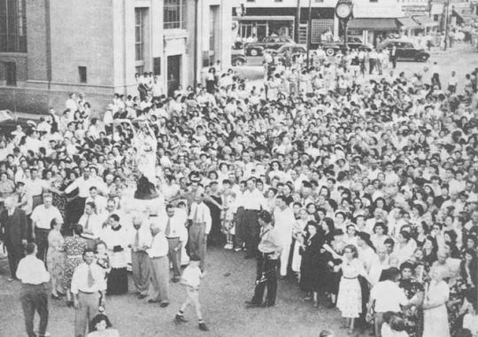 The streets of Hammonton fill with worshipers during Our Lady of Mount Carmel Feast Week in the 1940s. During World War II, 50,000 people turned out just for Feast Day - the final day of the event that includes the procession of statues, said Louie J. Pantalone, president of the Our Lady of Mount Carmel Society.