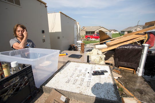 "Marlene Snider looks at what remains of her home in the Wheatland Acres subdivision in Celina, Ohio Tuesday, May 28, 2019. Snider said she and her husband spent the past year renovating their house, but plan to rebuild. Officials said in a statement that the northwest section of the city ""sustained significant damage from a tornado"" that passed through the community Monday night at about 10 p.m."