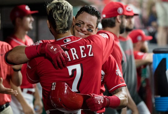 Cincinnati Reds left fielder Derek Dietrich (22) celebrates with Cincinnati Reds third baseman Eugenio Suarez (7) after hitting a home run in the seventh inning of the MLB National League game between Cincinnati Reds and Pittsburgh Pirates at Great American Ball Park in Cincinnati on Monday, May 27, 2019.