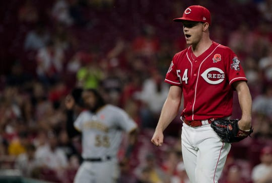 Cincinnati Reds starting pitcher Sonny Gray (54) celebrates after the end of the sixth inning where he gave up his first run of the night in the MLB National League game between Cincinnati Reds and Pittsburgh Pirates at Great American Ball Park in Cincinnati on Monday, May 27, 2019. Red's led 6-1 after the sixth inning.