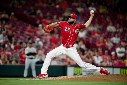 Cincinnati Reds pitcher Cody Reed throws pitch in the seventh inning of the MLB National League game between Cincinnati Reds and Pittsburgh Pirates at Great American Ball Park in Cincinnati on Monday, May 27, 2019.