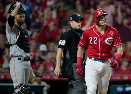 Cincinnati Reds left fielder Derek Dietrich (22) watch as his ball sales out of the park for a home run in the seventh inning of the MLB National League game between Cincinnati Reds and Pittsburgh Pirates at Great American Ball Park in Cincinnati on Monday, May 27, 2019.