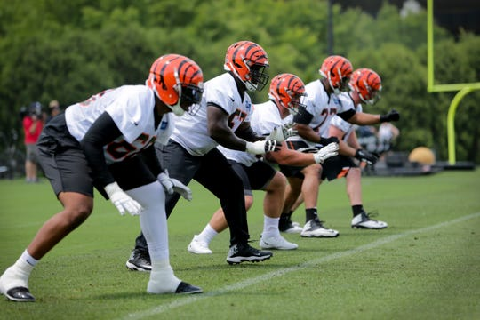 The Cincinnati Bengals offensive line, of offensive tackle Bobby Hart (68), offensive guard John Miller, center Billy Price (53), offensive tackle Cordy Glenn (77) and offensive tackle Jonah Williams (73), works out during Cincinnati Bengals organized team activities practice, Tuesday, May 28, 2019, at practice fields next to Paul Brown Stadium.