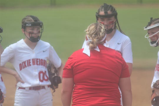 Dixie Heights head coach Sarah Osborne talks to her team as Dixie Heights defeated Holy Cross 19-11 in the quarterfinals of the KHSAA 9th Region softball tournament May 27, 2019 at Dixie Heights High School, Edgewood KY.
