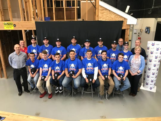 (Back, left to right) SCVTHS Electrical Construction Instructor Mike McClain, SCVTHS students Jacob DuMont of Branchburg, Jeremy Salvato of Branchburg, Rich Baginski of Branchburg, Al Villaverde of Princeton, Brenden Ryan of Bridgewater, Ishmael Murillo of Bound Brook, Axel Segura of Bound Brook, SCVTHS Cooperative Education Coordinator Tom Heinbach, SCVTHS student Kenny Hecht of Raritan and SCVTHS Plumbing Instructor Bob Setlock, and (front, left to right) SCVTHS Supervisor of Career and Technical Education Mario Peluso, SCVTHS students Hunter Horton of Neshanic Station, Brad Livecchi of Bridgewater, Matt Gentile of Gillette, Osvin Osorio of Raritan, Kenton Asea of Martinsville, Gino Florio of Stirling, Justin Mollo of Washington and SCVTHS Principal Diane Ziegler pose for a photo during the signing day activities.