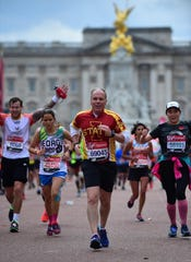 Ron Hankins, middle, runs the London Marathon in April. It was the 18th marathon he has completed.