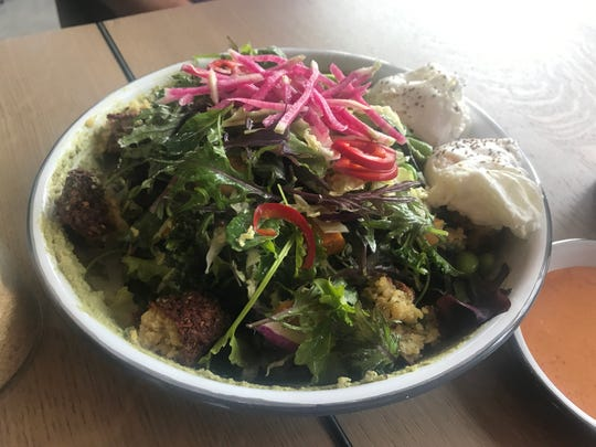 Eggs & Greens from St. Kilda Surf & Turf - green goddess hummus, roasted sweet potato, roasted broccolini, edamame, baby kale, watermelon radish, pickled Fresno chilies, torn falafel and poached eggs.