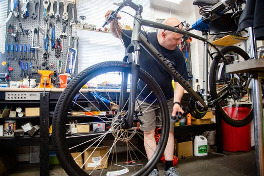 Sterling Heise, store manager at Rassy's bike shop assembles a new bike Wednesday, May 22, 2019.
