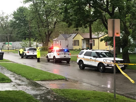 Investigators from the Polk County Sheriff Office and Des Moines Police Department work the scene of a shooting on the 1000 block of East Seneca Ave on Tuesday, May 28, 2019.