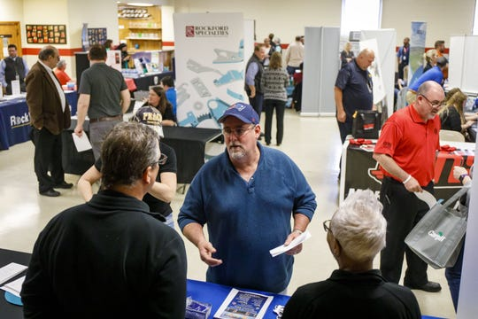 File photo: Mike Dovey, center, talks to prospective employers during a job fair on May 1, 2019, at the UAW Hall in Belvidere, Ill. Dovey was laid off by Fiat Chrysler. (Brian Cassella/Chicago Tribune/TNS)