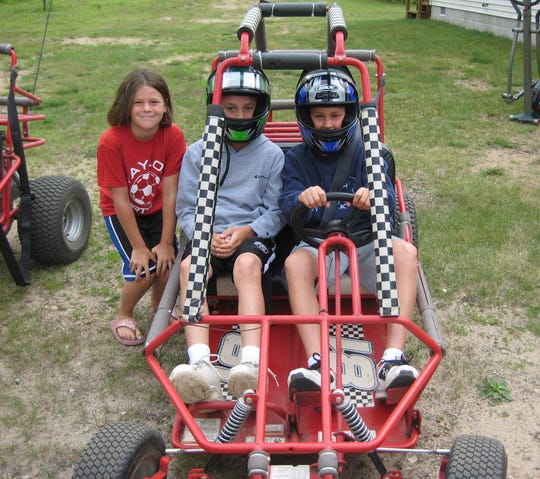 Detroit Bees teammates J.J. Bleday, right, and Tyler Thorington on a dune buggy during a trip Up North, with Thorington's sister, Katie, back in 2010.