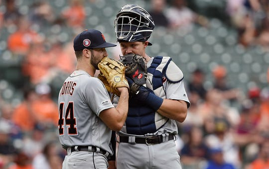 Detroit Tigers pitcher Daniel Norris, left, and catcher Grayson Greiner confer in the fourth inning of Monday's game against the Baltimore Orioles in Baltimore.