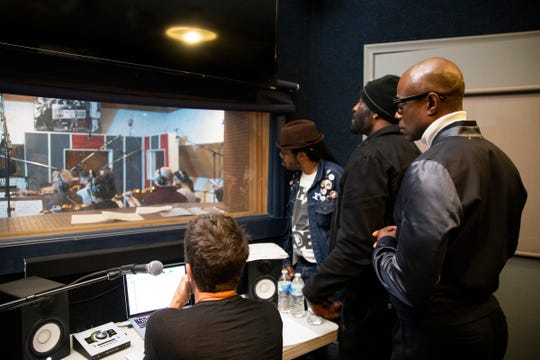 Recording artist Kem works with Motown legend and music arranger Paul Riser Monday, May 20, 2019 at the Motown Studio A in Detroit.