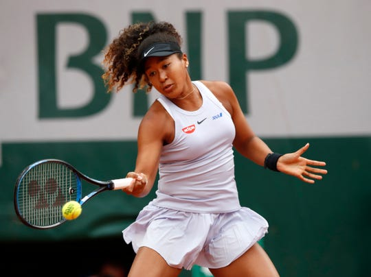Japan's Naomi Osaka plays a shot against Slovakia's Anna Karolina Schmiedlova during their first-round match of the French Open on Tuesday at the Roland Garros stadium in Paris.