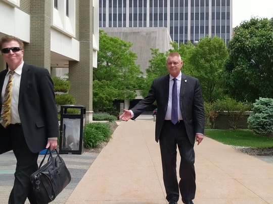State Rep. Larry Inman arrives at federal court in Grand Rapids on May 28, 2019.