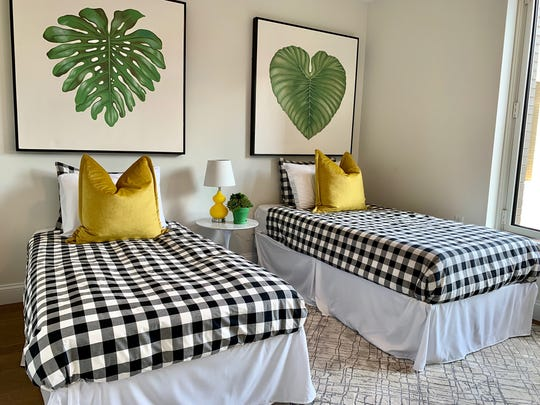 Classic plaid helps create a fresh and modern look in this children's bedroom. (Design Recipes/TNS)