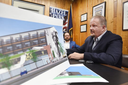 Hazel Park City Manager Edward Klobucher, right, with Jeffrey Campbell, the city's planning and economic development director, talks about development plans for  the site of a closed CVS drug store along John R Road in Hazel Park.