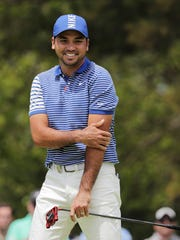Australian Jason Day is close with Michigan head football coach Jim Harbaugh, but he remains a die-hard Ohio State fan.