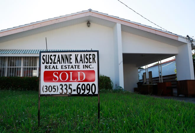 In this April 12, 2019, file photo, a sold sign is shown in front of a home in Surfside, Fla.
