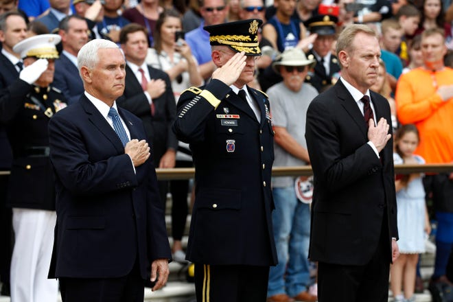 Vice President Mike Pence, from left, U.S. Army Maj. Gen. Michael Howard and Acting Defense Secretary Patrick Shanahan participate in a wreath-laying ceremony at the Tomb of the Unknown Soldier in observance of Memorial Day, Monday, May 27, 2019, at Arlington National Cemetery in Arlington, Va.