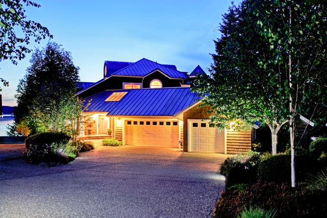 Outdoor lighting, driveway upgrades, landscaping and a clean exterior play a big role in curb appeal. (Dreamstime/TNS)