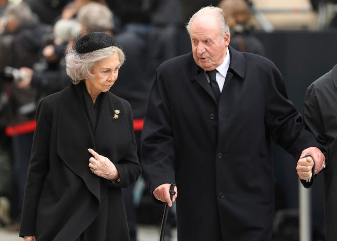 In this Saturday, May 4, 2019 file photo, Spain's emeritus King Juan Carlos, right, and emeritus Queen Sofia leave the Notre Dame cathedral after attending at the funeral of the Grand Duke Jean of Luxembourg, in Luxembourg.